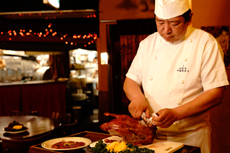 Peking Duck is served in front of you
